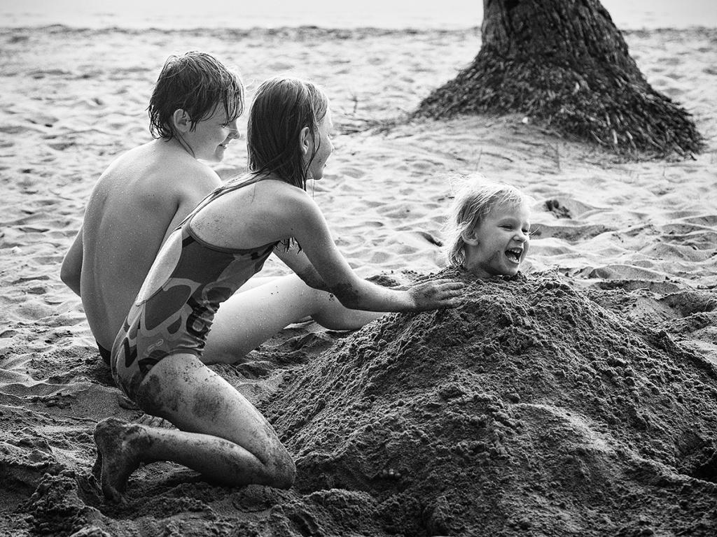 Genießen Sie den Urlaub mit der Fotokamera - Meer und Sand